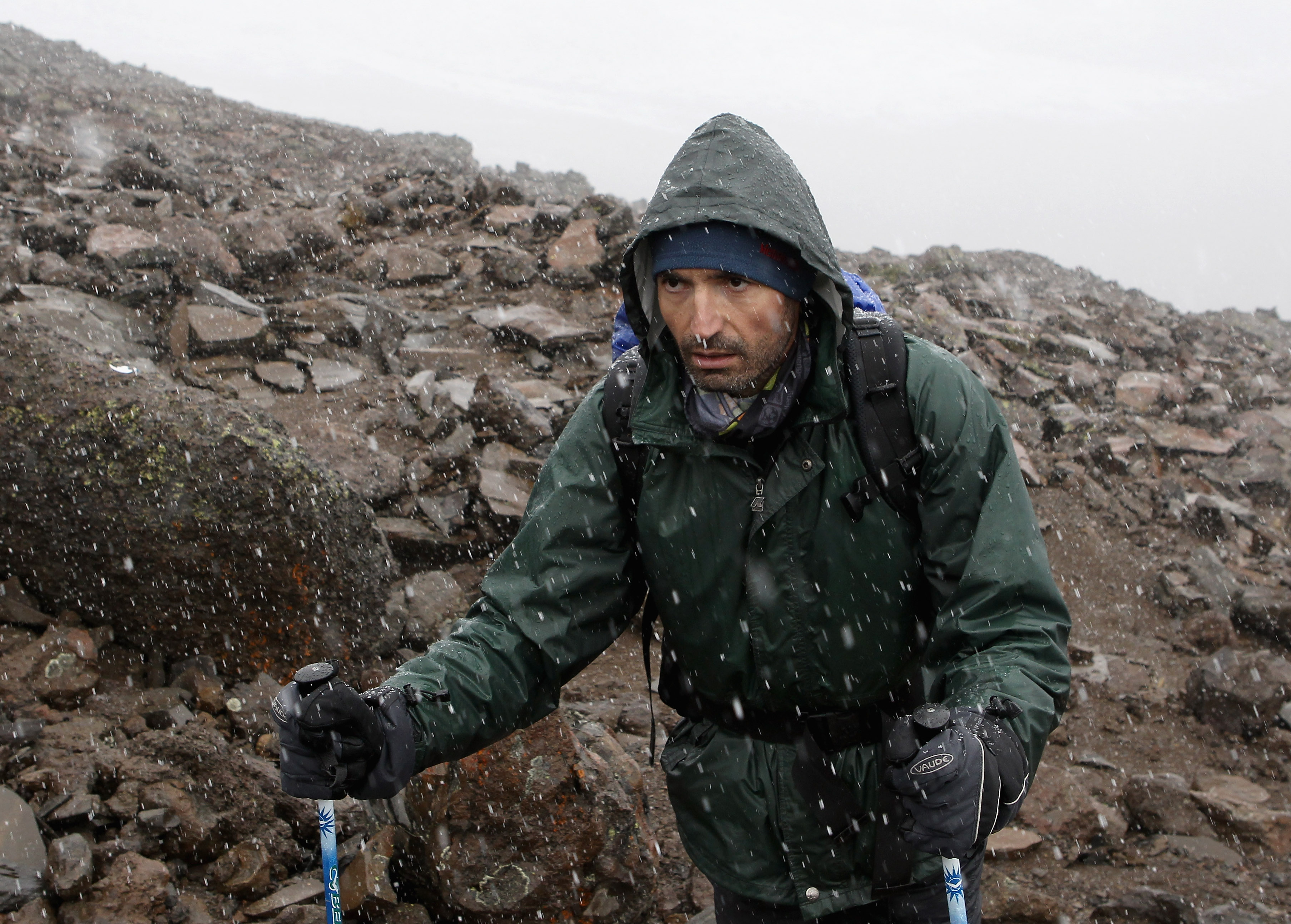 ARUSHA, TANZANIA - DECEMBER 10:  Laureus trekkers climb to high camp in a snow storm at around 4700m on day five of the Martina Navratilova Mt. Kilimanjaro Climb Day One on December 10, 2010 in Arusha, Tanzania. Martina Navratilova was forced to leave the mountain due to illness late last night but her team continue to climb Mount Kilimanjaro to raise money for the Laureus Sport for Good Foundation. Martina Navratilova, a member of the Laureus World Sports Academy will attempt to scale the 5895m peak, Africa's highest free standing mountain with a team of fundraisers including German Paralympic cyclist Michael Teuber and British badminton player Gail Emms .  (Photo by Chris Jackson/Getty Images for Laureus)